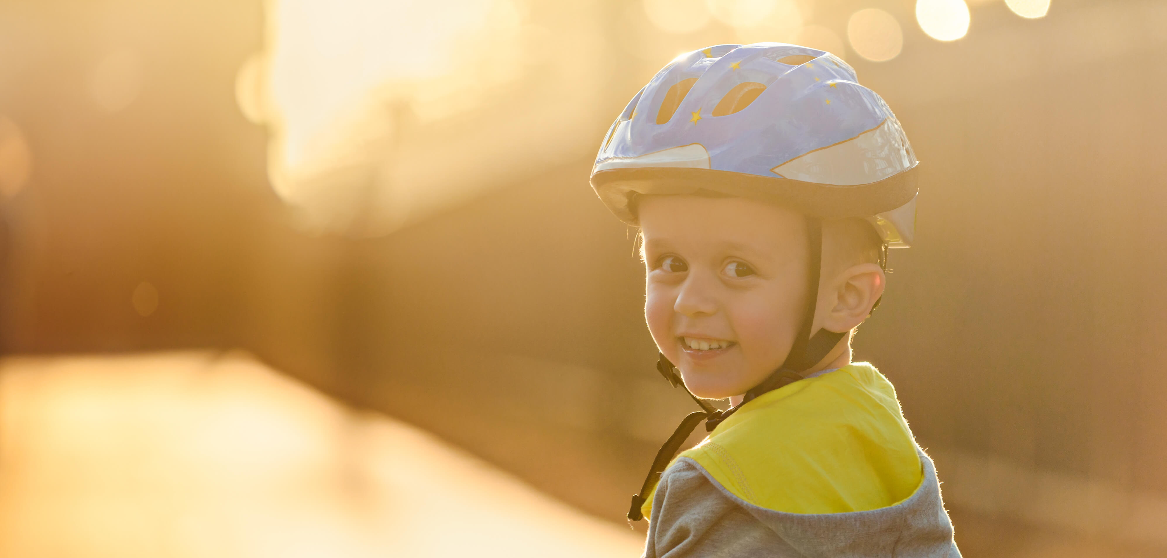 kid wearing helmet and smiling_third avenue